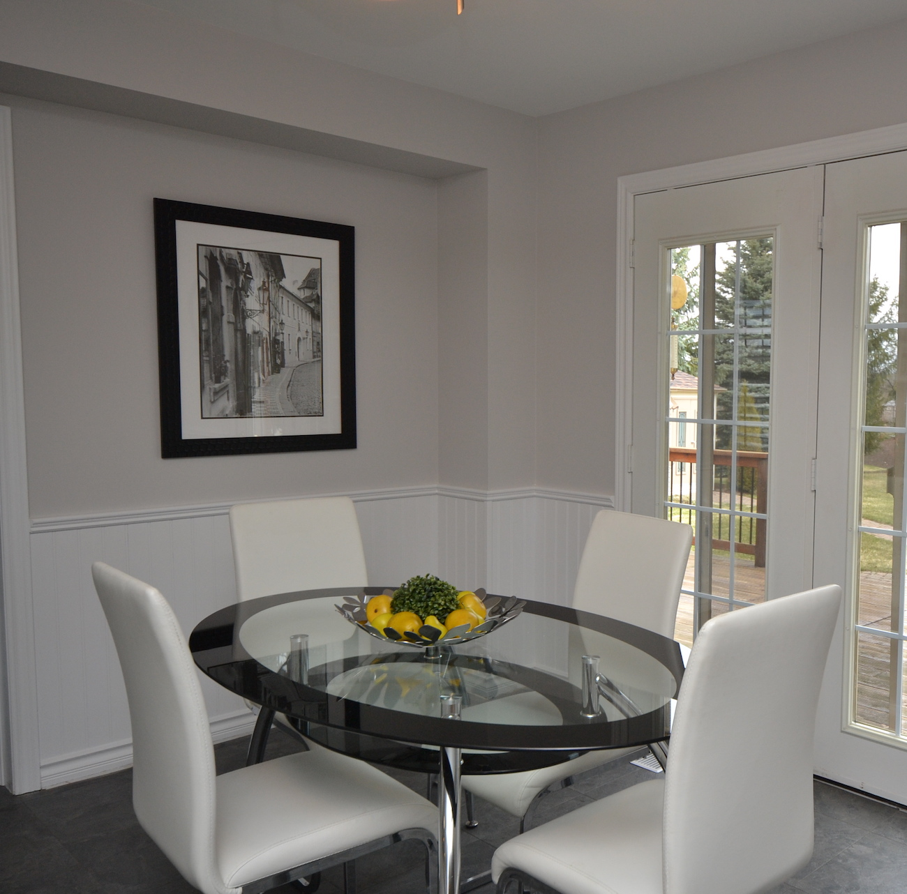 Oval Glass Kitchen Table with Four Off White Leather Chairs ...