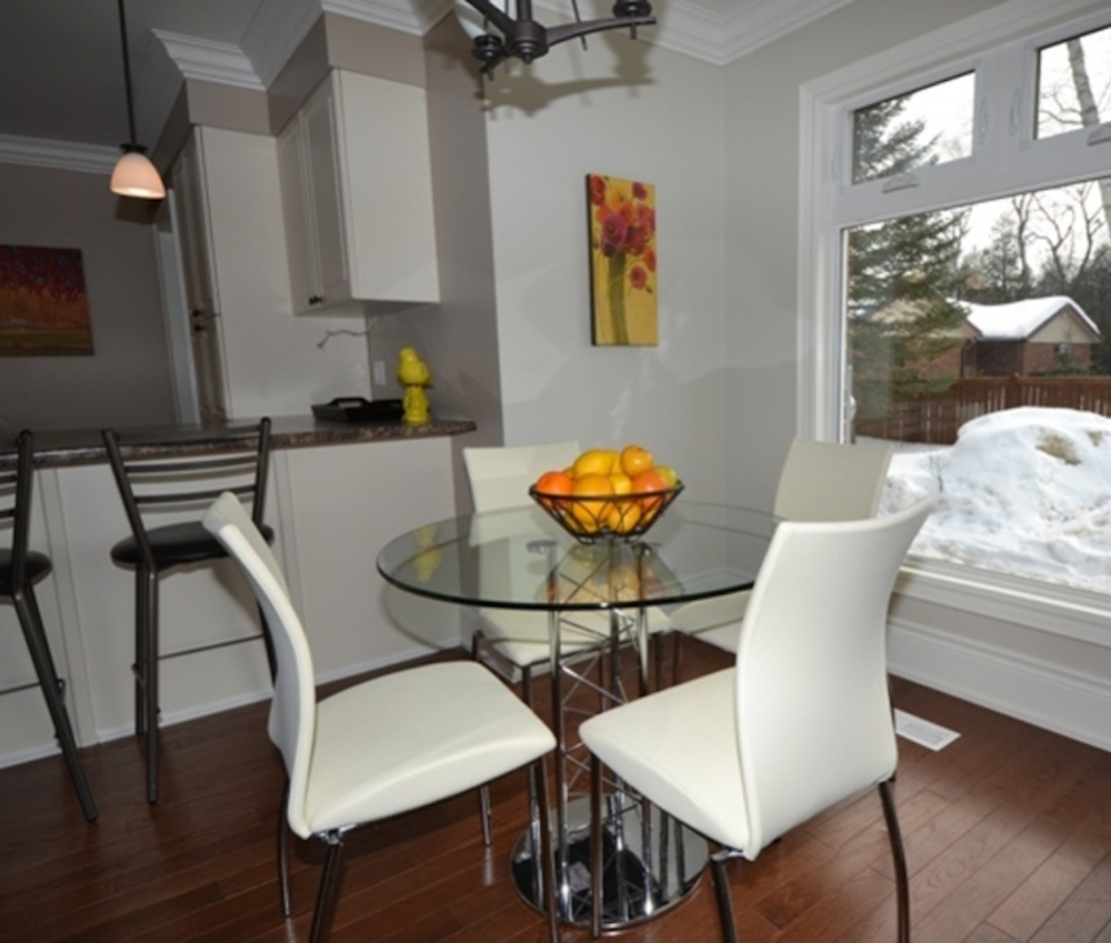 Living Room And Kitchen Stage By Synergy Staging: Glass Kitchen Table With Four White Leather Chairs